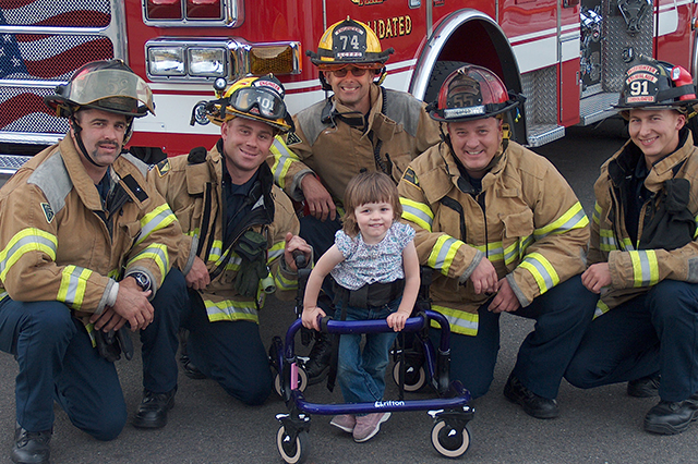 Firemen with little girl