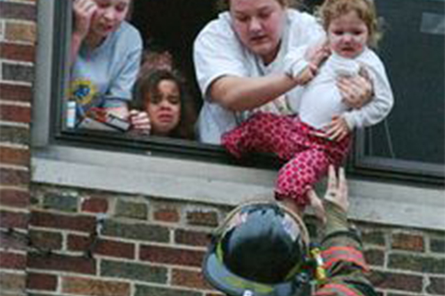 Fireman saving child